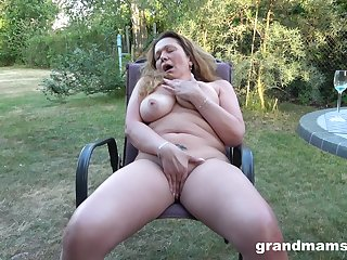 Granny rubs pussy and tits in sensual back yard solo