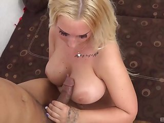Chubby pornstar Kyra Hot rides a large dick and gives a titjob