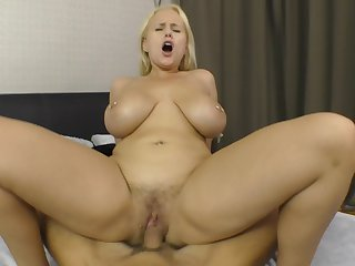 Busty blonde inferior rides dick in total modes