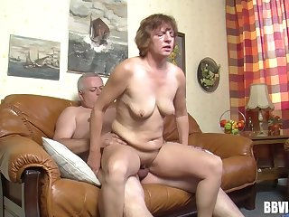 Fat dude with a epigrammatic dick fucks a dirty of age slut on the sofa