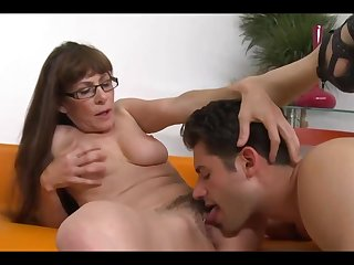 Grown up brunette with long hair and glasses is fucking her younger neighbor, just for fun