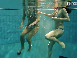 Girls Andrea and Monica stripping one choice underwater