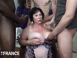 Horny granny fucked by several strong young guys