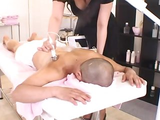 Smooth lovemaking on be passed on kneading table nigh a cute Japanese amateur