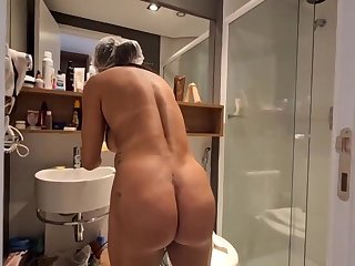 Brazilian dark haired with large, hard hooters, Bianca Naldy is object banged from the back, in the shower
